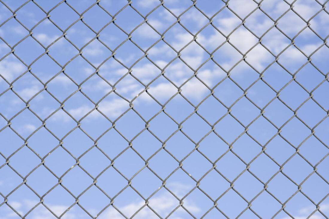 a gray chainlink fence